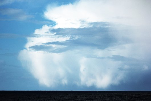 This huge rain cloud illustrates nicely the ever-changing weather of the North Atlantic (photo by Hauke Flores)