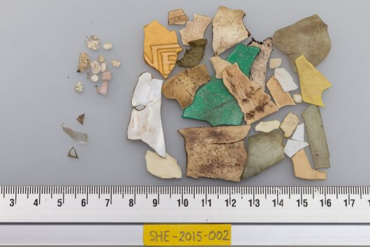 Cleaned and sorted plastics from fulmar SHE-2015-002, with smaller plastic foam bits (top left), some small sheetlike plastics (lower left), and many large hard plastic fragments (right) including one of the cap of a Nestlé instant coffee jar. (photo: Jan van Franeker)