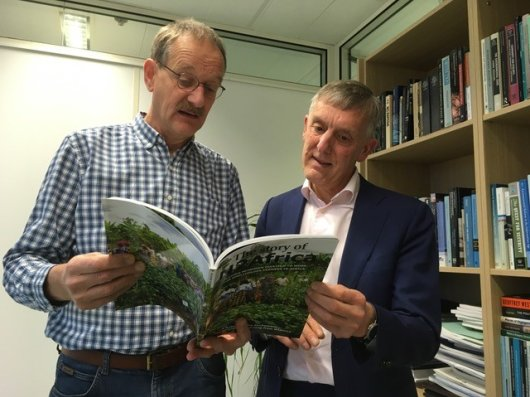 Ken Giller and Arthur Mol taking a look at the magazine