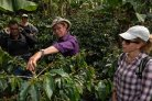 Alonso Carmona, center, talks about his coffee plantation with visitors including Mirjam Pulleman, right.