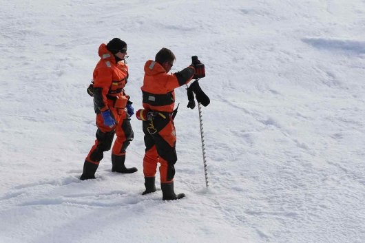 Ilka and Marcel (AWI) check the ice floe to see if it is suitable and safe to work on.