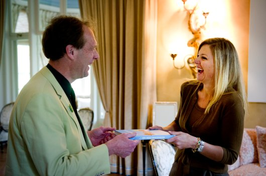 Prof Marcel Dicke gives the first copy of the Insect Cookbook to our Queen Maxima