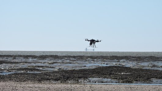Octocopter of Unmanned Aerial Remote Sensing Facility flying over mussel bank in Waddensea with Hyperspectral Mapping System (HyMSy)