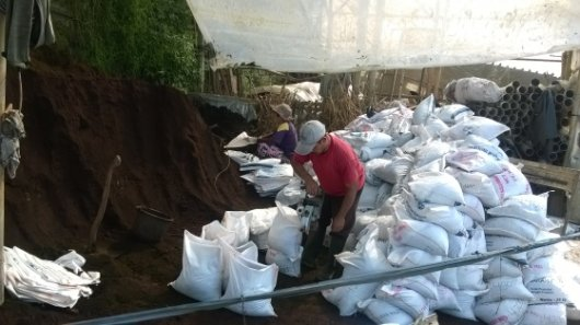 Filling bags with processed manure for sale