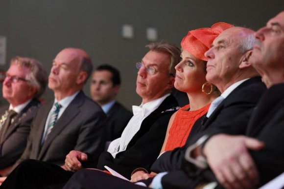 Queen Máxima, seated next to the executive board of Wageningen UR during the opening of the academic year 2013/2014, listens to the speech given by Henk Kamp, minister of Economic Affairs
