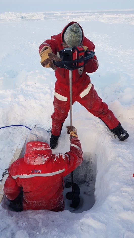 Scientists retreive the FishCam which is used to study the distrbution of fish in the Central Arctic Ocean (Credit: Clara Hoppe/Alfred Wegener Institute).