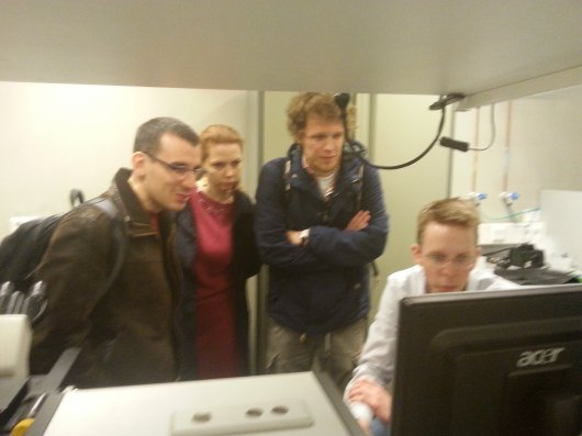 From left to right: Goran Kitić, Kristina Penezić and Marko Panić of BioSense, discussing spectroscopic measurements  with Arjen Bader of AFSG Biophysics, housing  the Wageningen Micro Spectroscopy Centre.